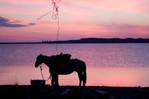 Unpacking at sunset on Lake fort Peck